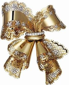 1945 VAN CLEEF & ARPELS Lace Bow Knot brooch in Yellow gold and platinum, and diamonds.