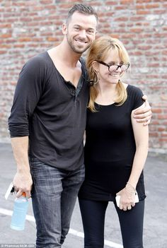 Matching partners: Actress Lea Thompson and her Dancing With The Stars dance pro Artem Chigvinstev posed for photos and showed off their happy smiles following a rehearsal on Sunday