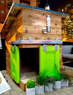 Dog Houses designed for a fundraiser. These are really cute ideas!    I like the barn door type doors in this pic... (maybe not the color...)