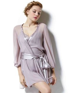 A sheer, sexy design in soft silk Georgette is dressed up with Charmeuse Satin belt and elastic cuffs.