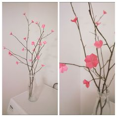 Folded paper cherry blossom on branches