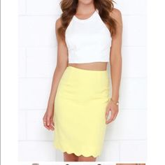 Hop, Scallop, and a Jump Yellow Pencil Skirt Brand new! Bought on sale with no returns, so had to keep it even though it didn't fit! Next time you're in a hurry, throw on the Hop, Scallop, and a Jump Yellow Pencil Skirt and you're sure to look good! A fitted, high waist with darting emphasizes your natural waistline, while delightfully textured poly in a lovely light yellow hue hugs your curves all the way down to a feminine scalloped hem. Kick pleat at back. Hidden back zipper. Fully lined…