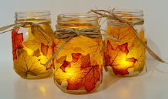 Decorate old mason jars with autumn leaves. Choose malleable leaves so they can bend and rub mod podge outside the jar. When the mod podge dries, hold the leaves until they stick. Repeat until you have reached your desired amount of leaves.