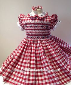 Red and White checked dress with smocking in white, red and blue. Ruffle on collar and sleeves.