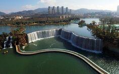 The manmade waterfall at the Niulanjiang Waterfall Park