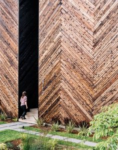 Passive House guidelines, like thick insulation, can often result in very simple forms, she says. Here, a recessed entrance in the shou sugi ban front facade provides privacy without complicating the design.