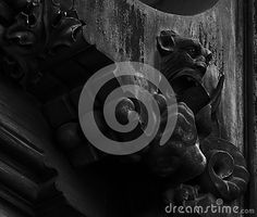 Shot in black and white, detail on an sculpture representing an strange creature placed on the door of this historic building, set in Gothic district, Barcelona, Catalunya, Catalonia, España, Spain, Europa, Europe