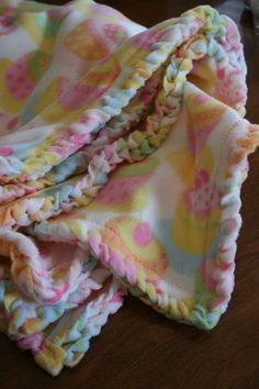 Nursery Decor/Blanket: Easy DIY Fleece Blanket with Crocheted Edge (from mesilla.wordpress.com). This is a much softer finish than the typical knotted fringe of other DIY fleece blankets.