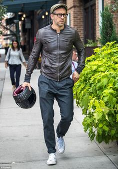Laid-back: Ryan Reynolds showed off his casual style in a chic, brown leather jacket, dark wash jeans, and low-top sneakers while out in New York City on Monday