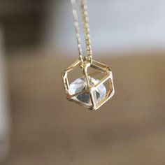 Gold Geometric Necklace, Gold diamond necklace, Whimsical necklace, Floating diamond necklace, Gold crystal necklace, Hollow polygon charm by Akamatra on Etsy https://www.etsy.com/uk/listing/238351676/gold-geometric-necklace-gold-diamond