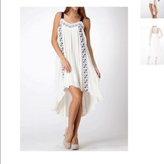 """The Milk Maiden High-Low Dress Modeled on a size Small. Model's profile: height 5'9"""", bust 32"""", waist 24"""", hips 34"""" CONTENT & CARE Polyester (Self) Nylon (Contrast)  Imported Line Dry Color: Cream with Navy Accent Harper Trends Dresses High Low"""