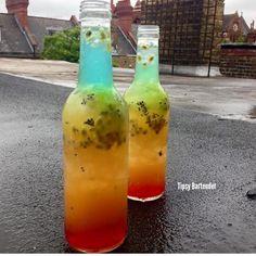 CARNIVAL VIBES  Red Layer: Strawberry Daiquiri Mix Crushed Ice  Yellow Layer: 1/2 passion fruit muddled with 1/2 Mango Vodka + Mango Juice   Green Layer : 1/2 kiwi muddled with Malibu  Blue: Rum + blue Curaçao