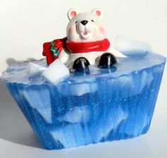 $5 Cute little polar bear sitting inside the blue ocean with icebergs all around. This custom listing is in cotton candy fragrance. The blue ocean water has little sparkles that glisten when the light hits it.