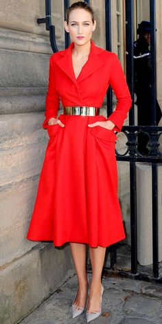 At Paris Fashion Week, Leelee Sobieski stood out at the Dior show in the label's belted scarlet design and pointy-toe pumps.