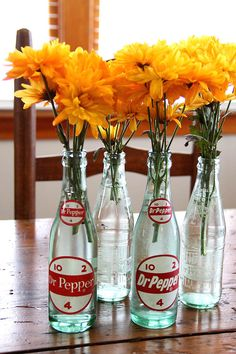 Bright flowers, antique bottles.Collecting Dr.Pepper bottles is fun, there are more styles than I ever imagined.
