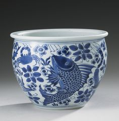 A BLUE AND WHITE 'FISH' JARDINIERE  QING DYNASTY, KANGXI PERIOD of deep U-shape with a flat everted rim, painted around the sides in clear blue tones with a mackerel, a white fish, a carp and a freshwater perch amid waterweed, various crustaceans and shellfish, between double-line borders, the interior plain, the slightly concave base unglazed