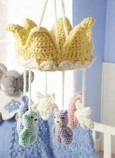Treat your precious little one to a royal mobile with fascinating bunnies and bears and stars. Each is attached to a regal crown designed to lull baby to sleep.