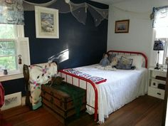 My nautical room, my family are commercial fishermen. Made the throw, covered the lamp shades, spray painted the bed.