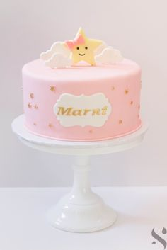Twinkle Twinkle Little Star fondant birthday cake with star topper and name plaque.