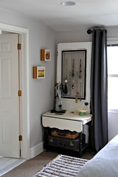 """Sabia collects old doors and found uses for them around the bedroom. """"I feel like it adds to the room, and especially if you're a renter, it's a great idea to lean the doors up against the wall to hang things on so you don't have to make holes in the walls,"""" she says. Here, an old door acts as a jewelry organizer."""