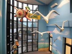 Worlds of Wow - A plane and seagulls hang over the beach entrance at Trinity Baptist Church, Lake Charles, LA. Kids Church Decor, Children Church, Attic Game Room, Kids Play Centre, Indoor Play Equipment, Worlds Of Wow, Church Nursery, Church Design, Beach Kids