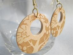 Large lightweight wooden disks with tree motif earrings by MsL2L, via Flickr