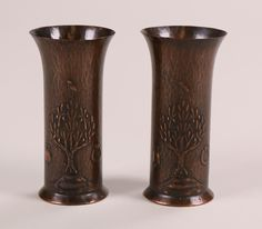 "Pair of English Arts & Crafts hammered copper vases by the Keswick School of Industrial Art.  Signed KSIA on bottom.  Excellent new patina.  5.5""h x 2.75""d"