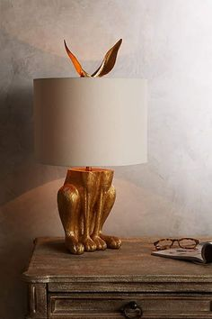 This gilded hare lamp makes a great statement piece for your nursery || Anthropologie