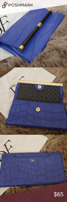 DvF Envelope Clutch Worn 3 times. Lovely purplish-blue embossed leather clutch. One outside pocket on the back easily accommodates a smartphone. Plenty of room inside for all your going-out essentials. Diane Von Furstenberg Bags Clutches & Wristlets