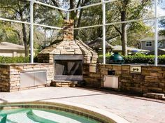 outdoor fireplace in a screened in lanai