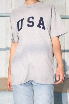 Oversized fit cotton top in light heather grey with USA embroidered on the chest in navy blue and white. Brandy Melville Usa, Heather Grey, Short Sleeves, Blue And White, Sweatshirts, Swimwear, Sweaters, Cotton, Mens Tops