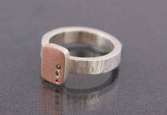 Cell Ring-Rectangle with sterling silver, 14k pink gold and champagne diamonds from the Cells and Windows Collection by EC Design. American Made. See the artist's work at the 2014 Buyers Market of American Craft, Philadelphia, PA. January 18-21, 2014. americanmadeshow.com #ring, #rectangle, #sterlingsilver, #14kpinkgold, #champagnediamonds, #jewelry, #americanmade