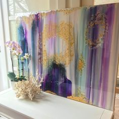 Large abstract painting with golds and purples