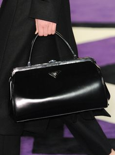Prada Fall 2012  My mother had a purse just like this one.  This was the style in the 60's.  I so wish I had it today.