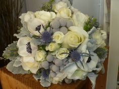 Beautiful Winter bridal bouquet in white,gray & blue tones.