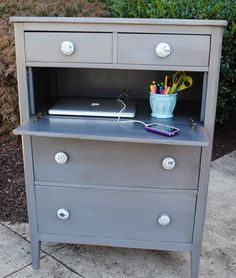 drawer removed; drawer face attached by hinge to new? wood piece horizontal inside so closeable (drawer face retains knobs) ...use as mini desk, surface, etc, when open, or as way to hide electronics or other things if closed