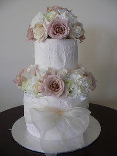 similar to the wedding cake that i would like. would probably have the cakes wider and maybe not as tall.