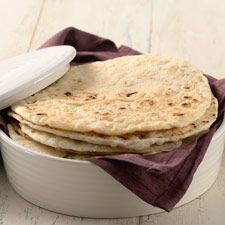 "Simple Tortillas - Soft and tender, with just a little bit of ""chew,"" you can have these on the table in under an hour."