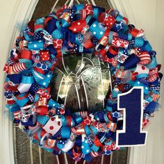 My Dr. Seuss ribbon wreath for a 1st Birthday!!  I have a hat to replace the 1 when all done!! :)
