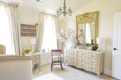 Perfect use of my vintage French Provincial bedroom set from growing up, in a nursery setting.