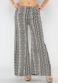 "We love printed pants, and the ""Hollywood Squares Flare Pants"" are no exception! These light-weight, wide legged pants feature a funky black and white geometric design. You will love the fit, especially because these feature an elastic waist!"