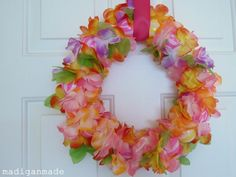love this summery wreath made out of $store party lei petals and bouncy little colourful balls by MADIGAN MADE