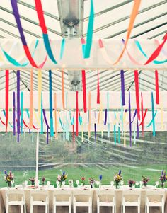 Hang colorful ribbons from the ceiling at the reception… | 35 Incredibly Fun Ways To Add Color To Your Wedding