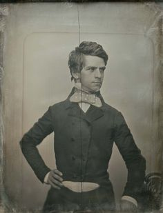 "Men's Crinoline Styles are fairly simple with narrow trousers and waists which mirror women's (raise to ""waist-level"" as the era progresses). Here a man wears a double-breasted coat with a notched collar and patterned necktie. Photo by Southworth and Hawes, 1852"