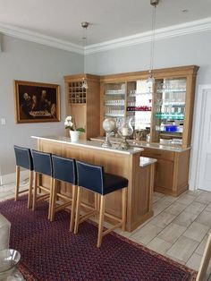 Solid oak bar cupboards with jax oleum finish.  Kühn Houtwerke is situated in the Boland, Cape Winelands area. We specialize in kitchen cupboards, bedroom cupboards, solid woodworking, custom furniture and much more. For a quotation please send an email to khoutwerke@icon.co.za and we will be happy to assist. Follow us on Pinterest for our latest pins. Bedroom Cupboards, Kitchen Cupboards, Wine Cellars, Bar Counter, Custom Furniture, Solid Oak, Quotation, Cape, Woodworking