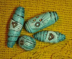 antiquing glaze really brings out the detail in these rolled beads -tutorial Page's Creations.