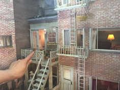 A miniature model of the set for Alfred Hitchcock's REAR WINDOW (1954) | Created by Louise Krasniewicz