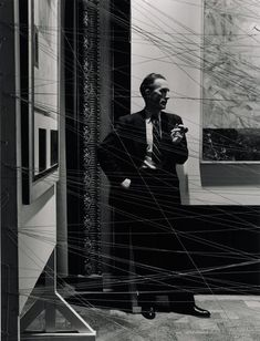 """archives-dada: """" Arnold Newman, Marcel Duchamp behind his installation of """"sixteen miles of string"""" New York, 1942 © 1942 Arnold Newman / Getty Images """" History Of Photography, Artistic Photography, Portrait Photography, Surrealism Photography, Surrealism Art, Street Photography, Man Ray, Hans Richter, Hans Arp"""