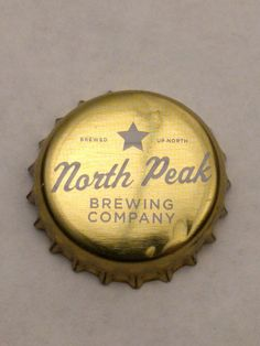 Cap#3 North Peak Brewing Company Traverse City, Michigan Condition: Good, visible dents