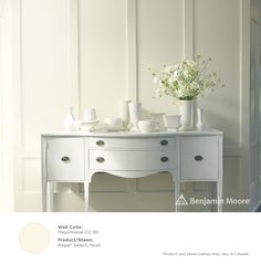 White painted sideboard with white pottery and white flowers . A stunning presentation. Wall: Mayonnaise with Regal Select, Pearl finish